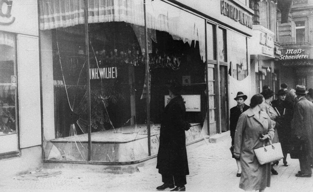 A man looks at the wreckage of a Jewish shop in Berlin on Nov. 10, 1938, in the aftermath of Kristallnacht, an organized nationwide attack carried out by Nazi paramilitary forces and German civili ...