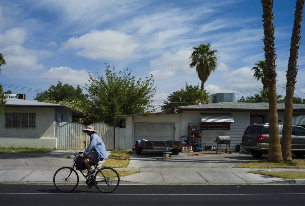 A man rides a bicycle along Oakey Avenue near 15th Street as clouds fill the sky in Las Vegas on Wednesday, May 10, 2017. (Chase Stevens/Las Vegas Review-Journal) @csstevensphoto