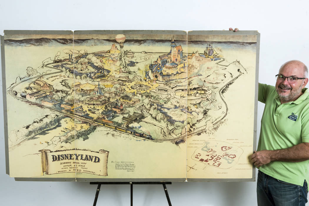 Photo art dealer Mike Van Eaton stands next to a hand-drawn map from 1953 that shows Walt Disney's original ideas for Disneyland displayed at the Van Eaton Galleries in Sherman Oaks area of Los An ...
