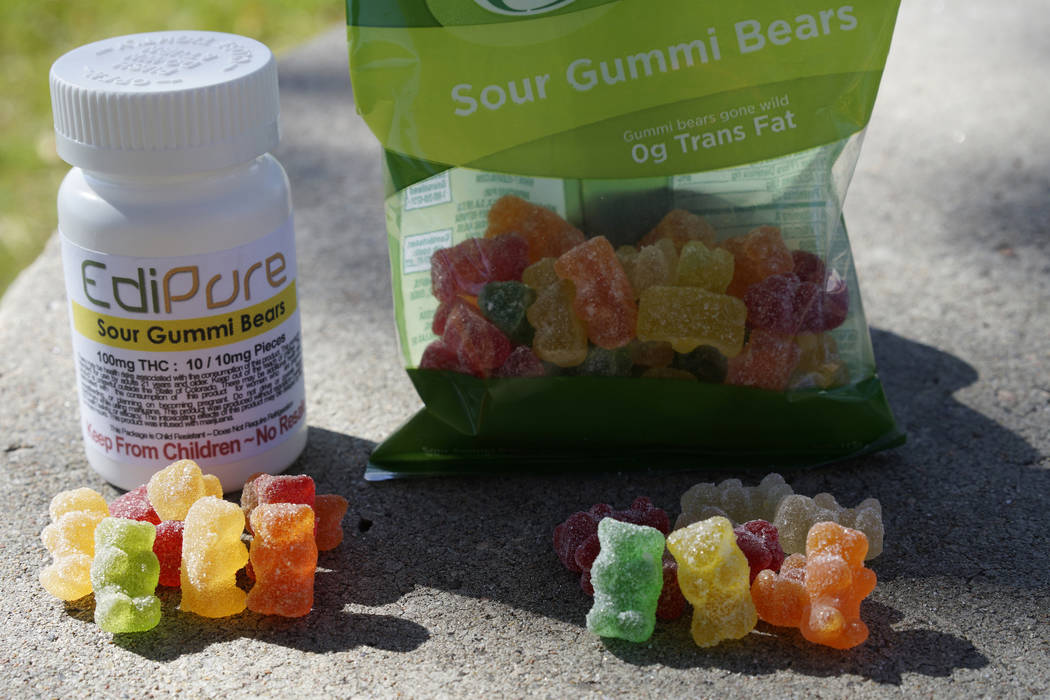 Marijuana-infused sour gummy bear candies (L) are next to regular ones at right in Northglenn, Colorado October 16, 2014. (Rick Wilking/Reuters)