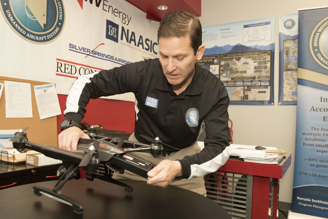 Chris Walach, director of operations of unmanned aviation for Nevada Institute for Autonomous Systems, discussed the battery life a Yuneec Q500 4K quadcopter following a flight demonstration at hi ...