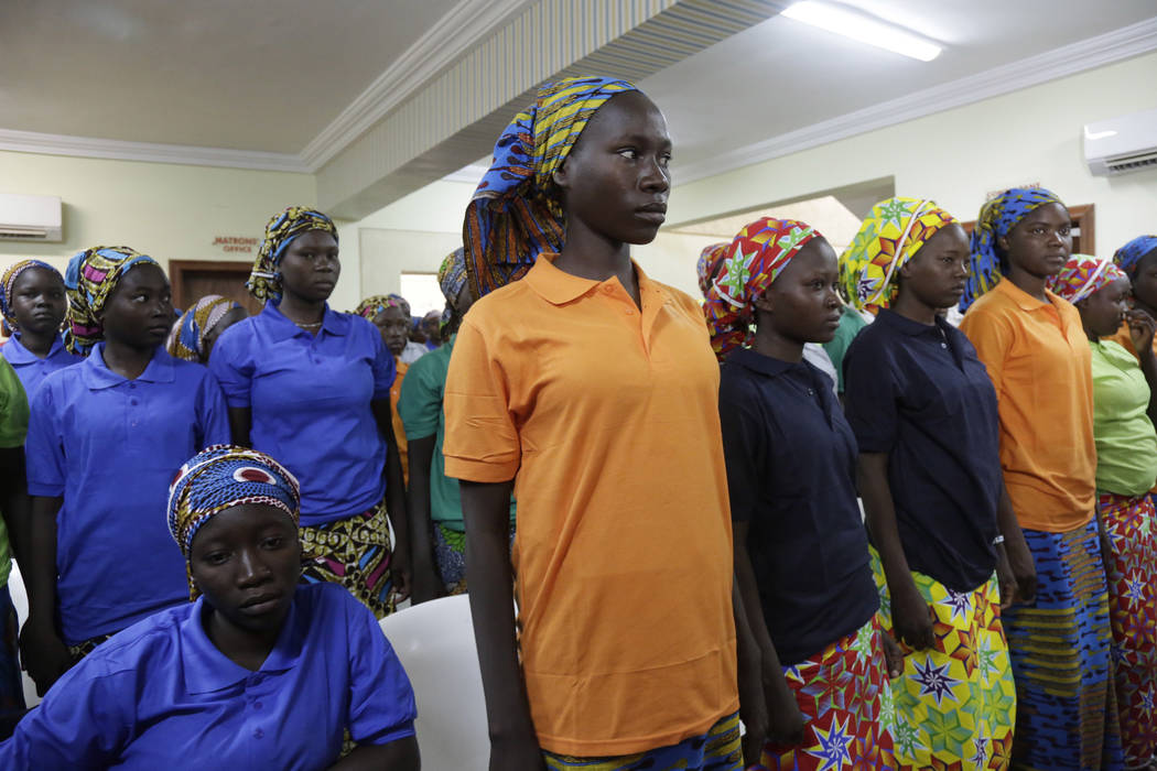 FILE- In this Monday, May 8, 2017 file photo, Chibok schoolgirls, recently freed from Nigeria extremist captivity, are photographed in Abuja, Nigeria. (Sunday Alamba/AP)