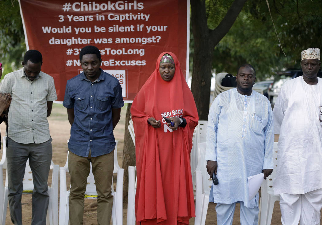 Campaigners observe a minute silent for the remaining Kidnapped schools during their daily sit outs in Abuja, Nigeria. Tuesday. May 9, 2017. (Sunday Alamba/AP)