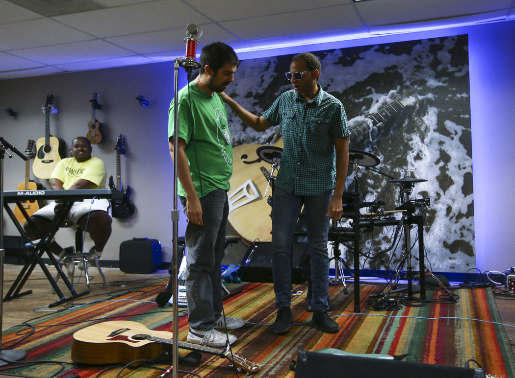 Ivan Delgado, center left, and Anthony Andrews of Broken Spectacles talk during a break at band practice at the Blind Center in Las Vegas on Thursday, May 4, 2017. (Chase Stevens/Las Vegas Review- ...
