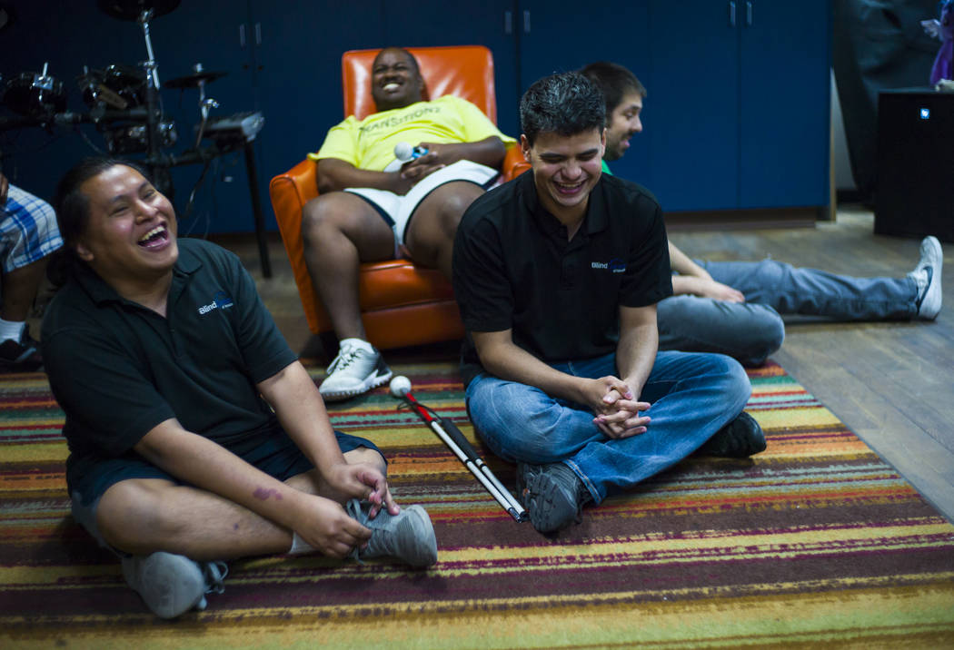 Christian Anorve, left, and Gus Garcia, center right, of Broken Spectacles, share a laugh during a break at band practice at the Blind Center in Las Vegas on Thursday, May 4, 2017. Chase Stevens L ...