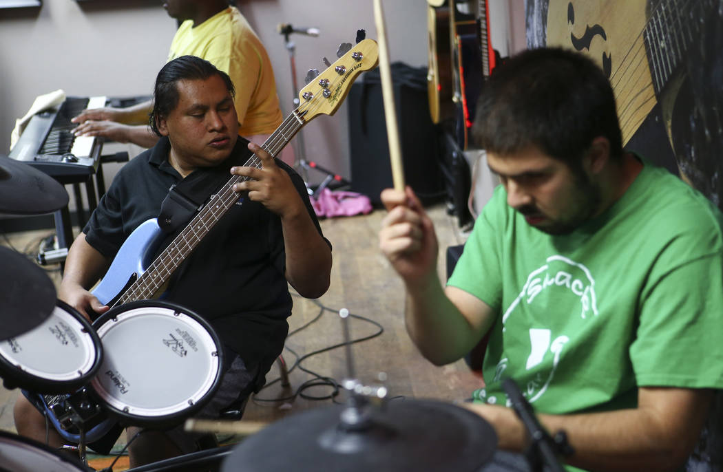 Christian Anorve, left, and Ivan Delgado of Broken Spectacles perform during band practice at the Blind Center in Las Vegas on Thursday, May 4, 2017. (Chase Stevens/Las Vegas Review-Journal) @csst ...