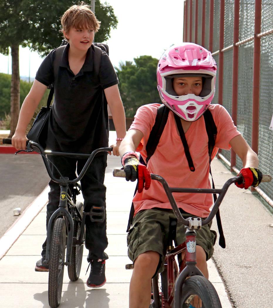 Matthew Nichols, 12, left, and Pierce Mirich, 12, bike to Ralph Cadwallader Middle School, Wednesday, May 10, 2017. Gabriella Benavidez Las Vegas Review-Journal @latina_ish