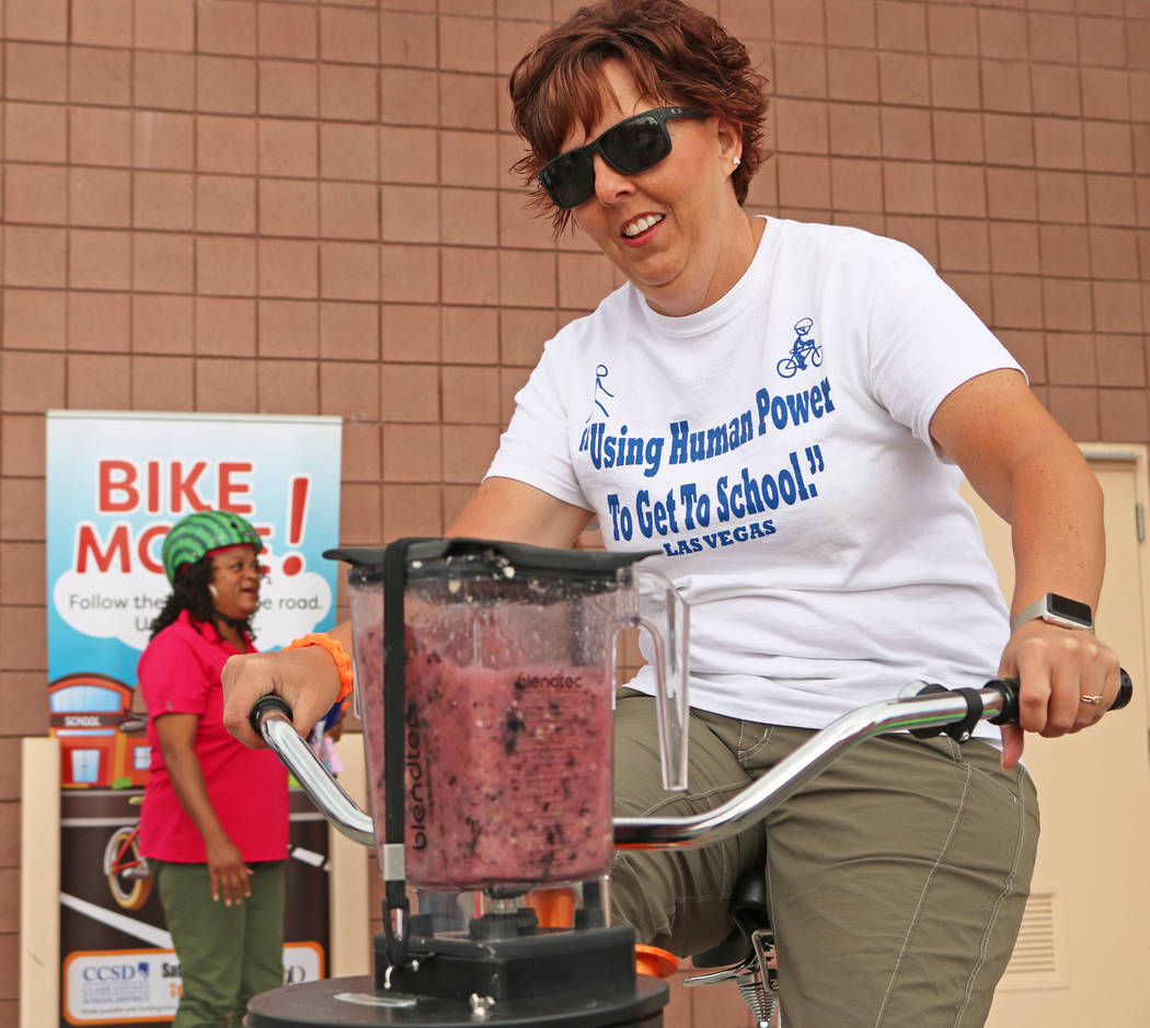 6th grade science teacher Brandy Cahoon uses a stationary bike to blend a smoothie at Ralph Cadwallader Middle School's Bike to School event, Wednesday, May 10, 2017. Gabriella Benavidez Las Vegas ...