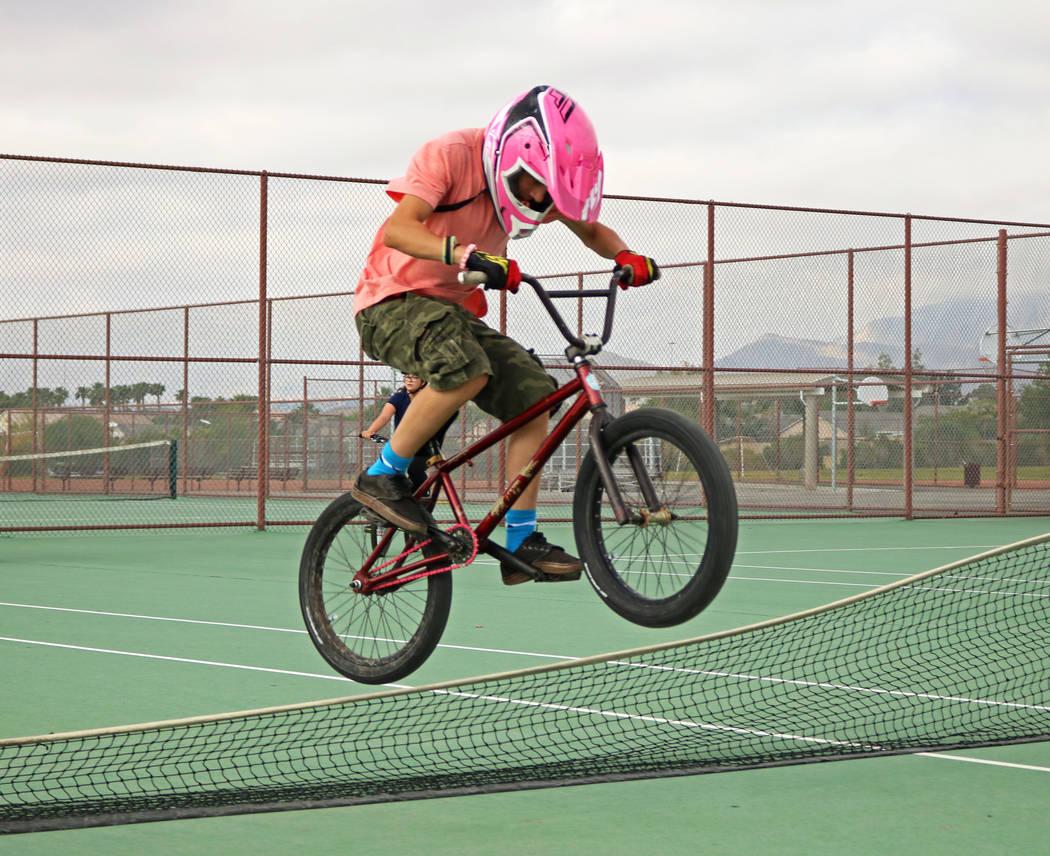 Pierce Mirich, 12, jumps over a lowered tennis net during the Bike to School event at Ralph Cadwallader Middle School, Wednesday, May 10, 2017. Gabriella Benavidez Las Vegas Review-Journal @latina_ish