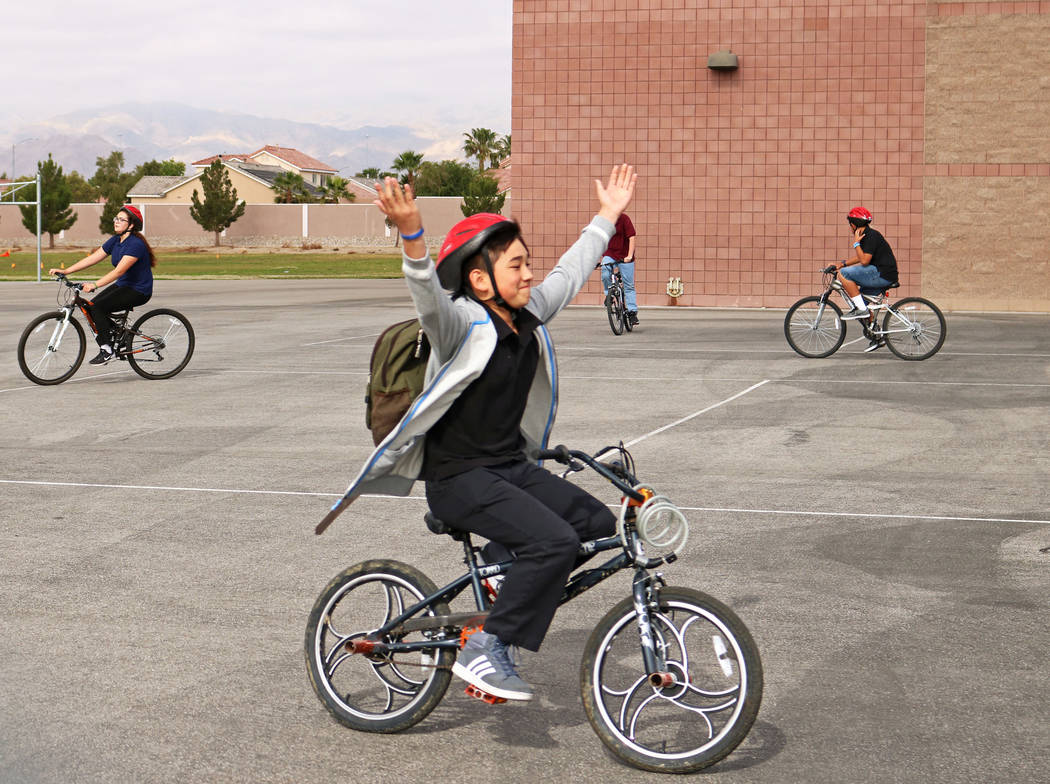 John Misas, 12, center, goes hands-free on his bike during the Bike to School event at Ralph Cadwallader Middle School, Wednesday, May 10, 2017. Gabriella Benavidez Las Vegas Review-Journal @latin ...