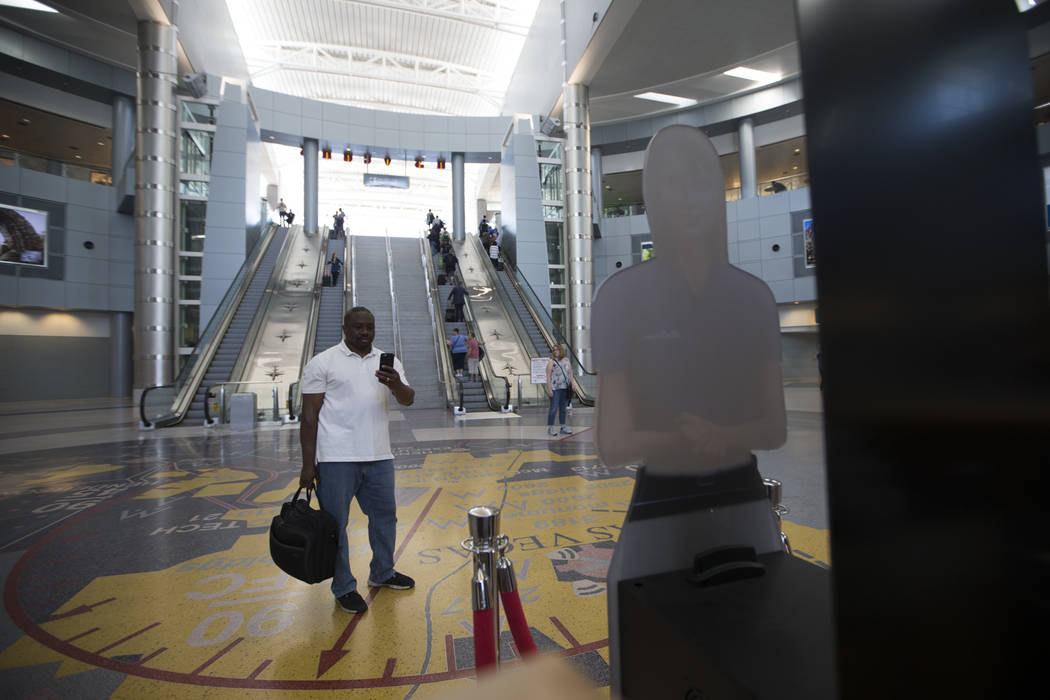 Wayne Abbott of New Jersey takes a photo of a self-service hologram at McCarran International Airport Terminal 1 on Thursday, May 11, 2017 in Las Vegas. Erik Verduzco Las Vegas Review-Journal @Eri ...