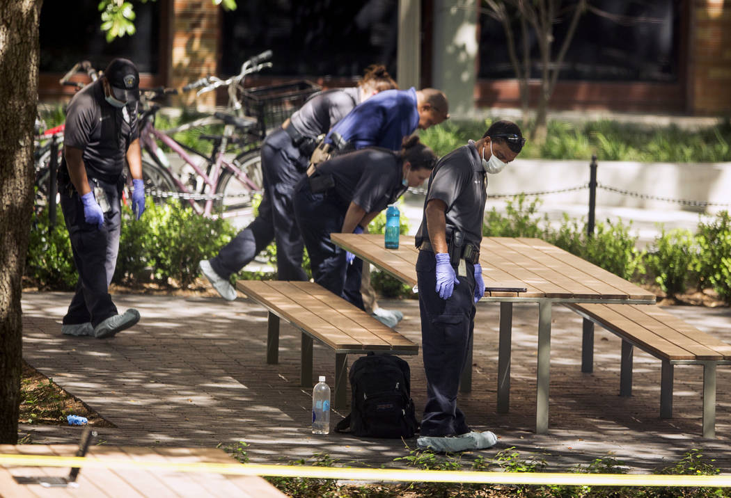 Officials investigate after a fatal stabbing attack at the University of Texas campus, Monday, May 1, 2017, in Austin, Texas. (Jay Janner/Austin American-Statesman via AP)