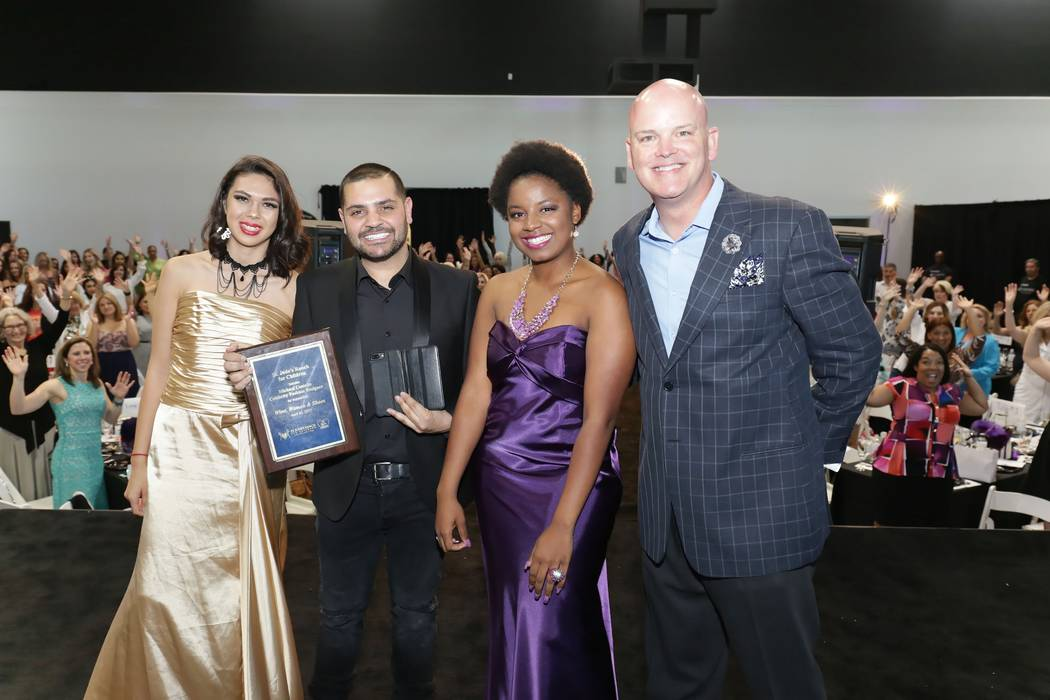 Teens Diamond Willis and Kiaira Williams from St. Jude's Ranch for Children give Michael a plaque to thank him for all his support especially the custom-made prom dresses he gave them. Chezaray  ...