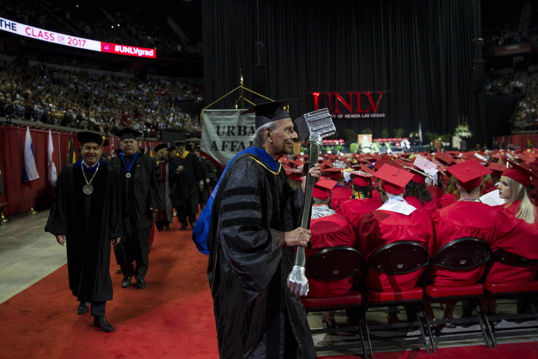 Professor Sadanand Verma leads the student and dignitary processional during an UNLV graduation at the Thomas & Mack Center on Saturday, May 13, 2017 in Las Vegas. Erik Verduzco Las Vegas Revi ...