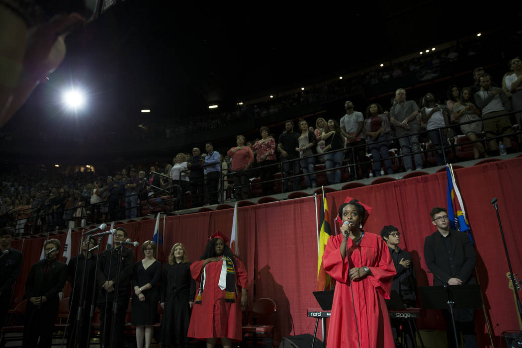 Jevoi Blount, vocal performance graduate, sings the national anthem during the UNLV graduation at the Thomas & Mack Center on Saturday, May 13, 2017 in Las Vegas. Erik Verduzco Las Vegas Revie ...