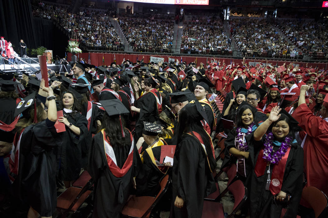 Nearly 3 000 Graduate From Unlv During Spring Commencement Ceremonies Las Vegas Review Journal Graduation regalia includes the cap and gown, as well as other distinguishing hoods, stoles and cords that denote traditions of academic achievement. las vegas review journal
