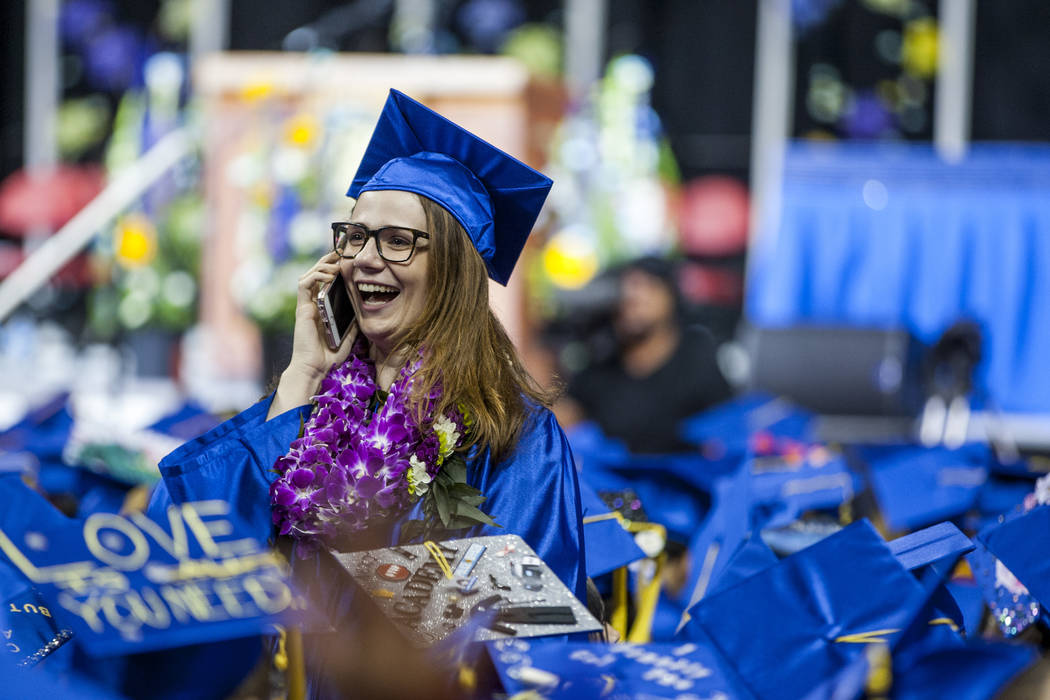 A College of Southern Nevada graduate talks with someone in the audience before the start of commencement at the Thomas and Mack Center in Las Vegas on Monday, May 15, 2017. Patrick Connolly Las V ...