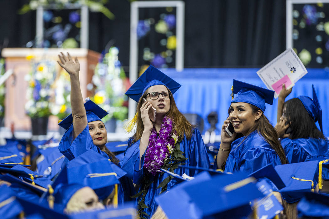 College of Southern Nevada graduates look for family and friends in the audience before the start of commencement at the Thomas and Mack Center in Las Vegas on Monday, May 15, 2017. Patrick Connol ...