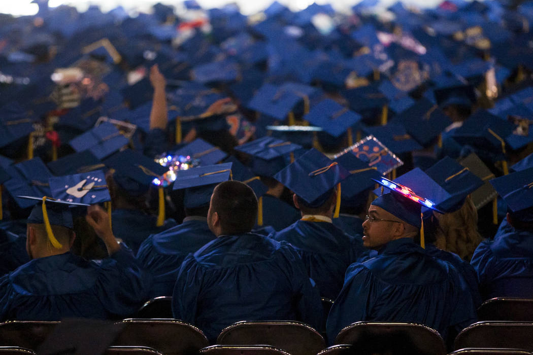 A graduate of the College of Southern Nevada sports a light up cap at commencement at the Thomas and Mack Center in Las Vegas on Monday, May 15, 2017. Patrick Connolly Las Vegas Review-Journal @PC ...