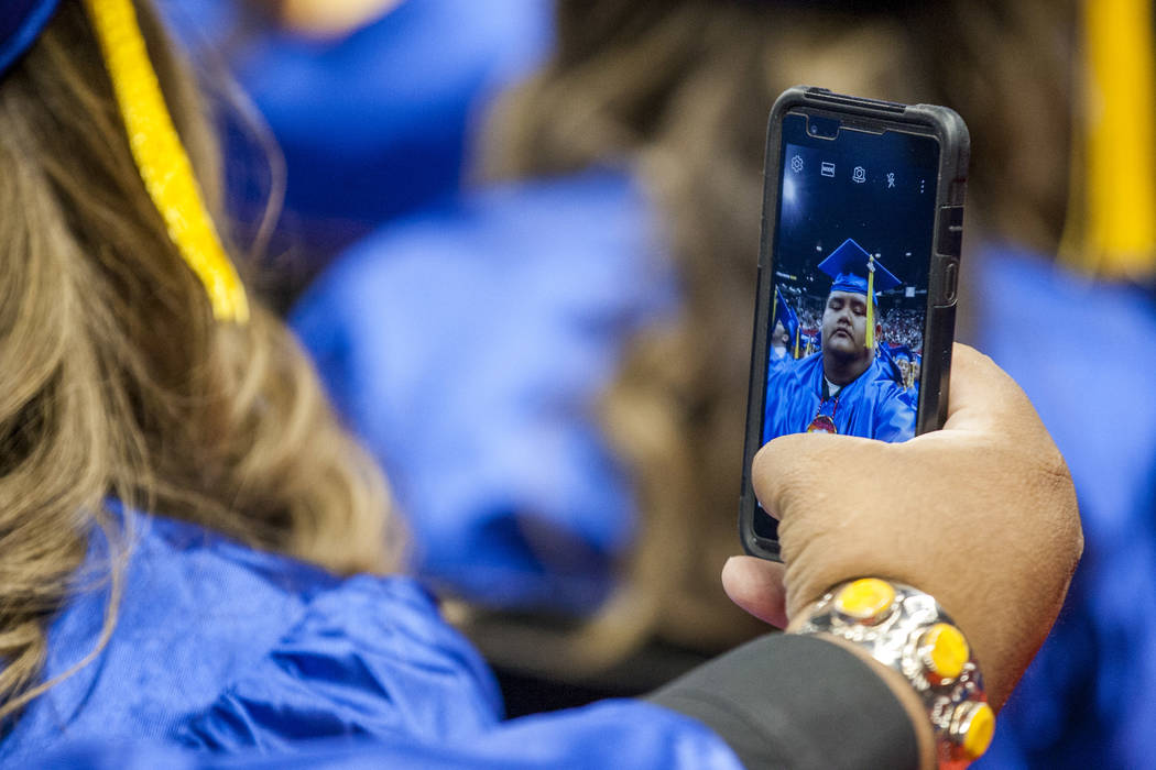 A College of Southern Nevada graduate takes a Snapchat during commencement at the Thomas and Mack Center in Las Vegas on Monday, May 15, 2017. Patrick Connolly Las Vegas Review-Journal @PConnPie