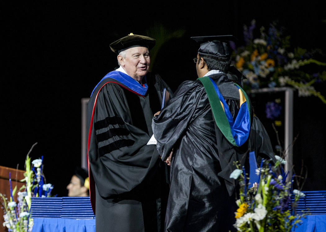 Dr. Michael D. Richards, president of College of Southern Nevada, presents degrees to graduates during commencement at the Thomas and Mack Center in Las Vegas on Monday, May 15, 2017. Patrick Conn ...
