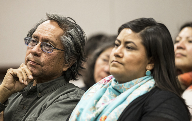 Joe Bryan, left, a member of the Washoe Tribe, listens to officials on the Senate Government Affairs Committee discuss a resolution to replace Columbus Day with Indigenous People Day at the Nevada ...