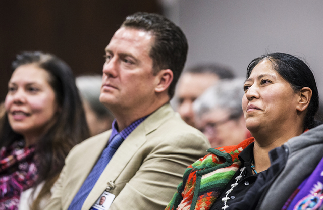 Raquel Arthur, right, listens to officials on the Senate Government Affairs Committee during a meeting to discuss a resolution to replace Columbus Day with Indigenous People Day at the Nevada Legi ...