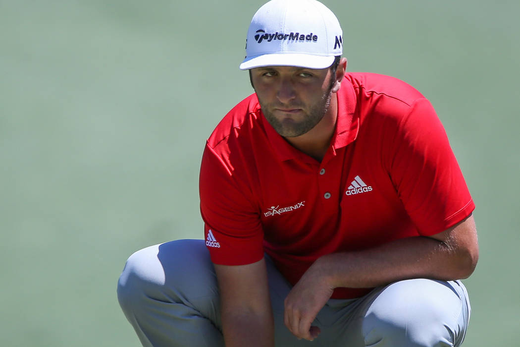 May 7, 2017; Wilmington, NC, USA; Jon Rahm of Spain looks over his line on three during the final round of the Wells Fargo Championship golf tournament  at Eagle Point Golf Club. Mandatory Credit: ...