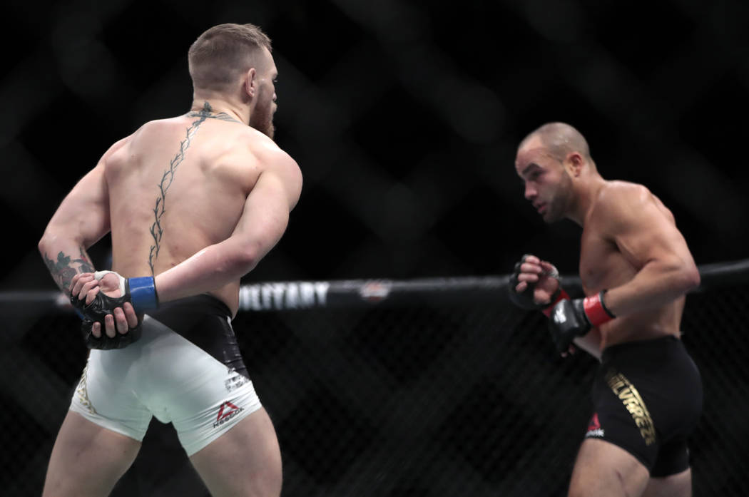 Conor McGregor, left, taunts Eddie Alvarez during a lightweight title mixed martial arts bout at UFC 205, early Sunday, Nov. 13, 2016, at Madison Square Garden in New York. McGregor won the bout.  ...