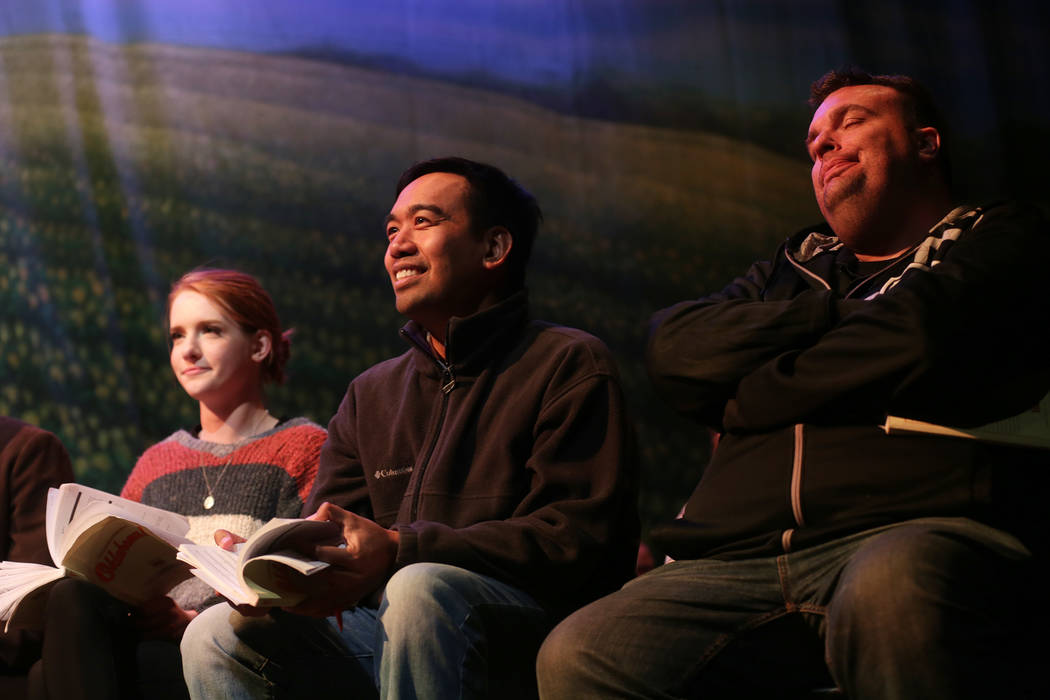 Jessica Vanek, as Ado Annie, from left, Jonathan Tuala, as Curly McClain, and Jonathan Baltera, and Jud Fry, watch their colleagues perform at the Oklahoma! rehearsal at the Super Summer Theatre a ...