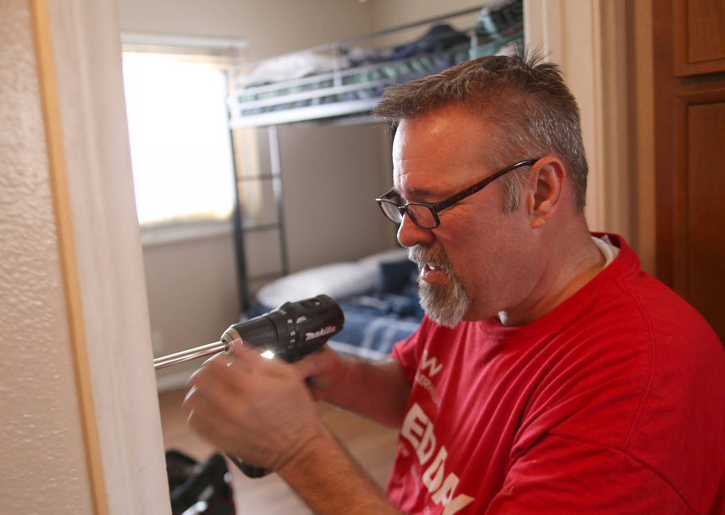 Volunteer Tod Barton replaces a broken door on Thursday, May 11, 2017, in Las Vegas. Keller Williams Realty agents and partner businesses renovate eight aging housing units for homeless youth that ...