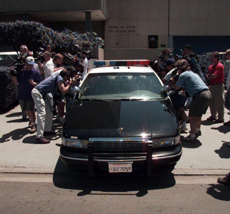Photographers surround the patrol car containing Jeremy Strohmeyer at it leaves the Long Beach, California, police station May 30, 1997. Las Vegas Review-Journal