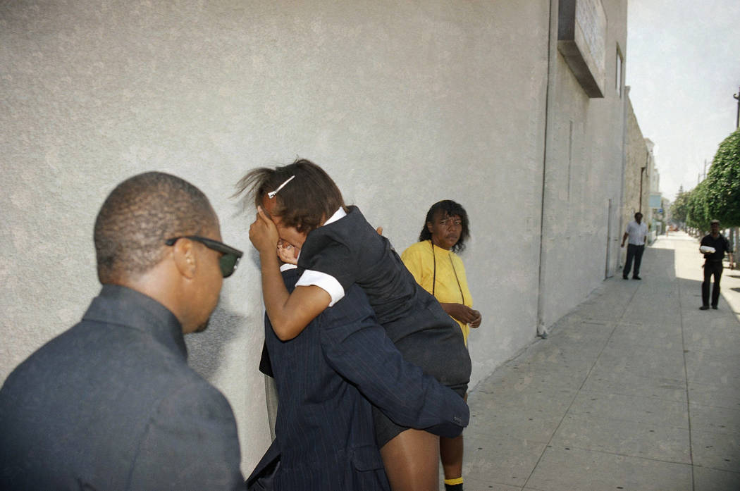 A crying family member of slain Sherrice Iverson is carried out of the 7-year-old's Los Angeles funeral service on May 31, 1997, just six days after the girl was sexually assaulted and killed in a ...