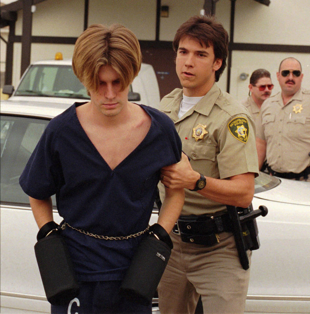 Jeremy Strohmeyer, left, charged with the kidnapping and murder of 7-year-old Sherrice Iverson in a casino in Primm, is taken into Goodsprings Justice Court by an officer on July 22, 1997, in Jean ...