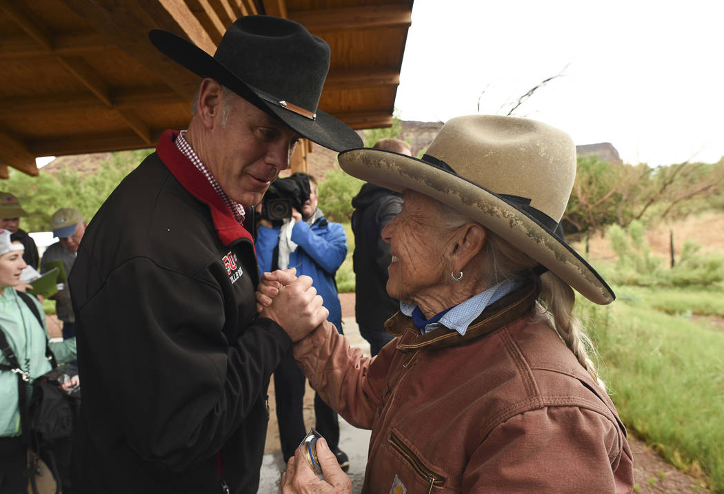 U.S. Interior Secretary Ryan Zinke, left, thanks Heidi Reed during his visit to historic Dugout Ranch along Indian Creek near Monticello, Utah, operated by Redd, under a conservation easement with ...