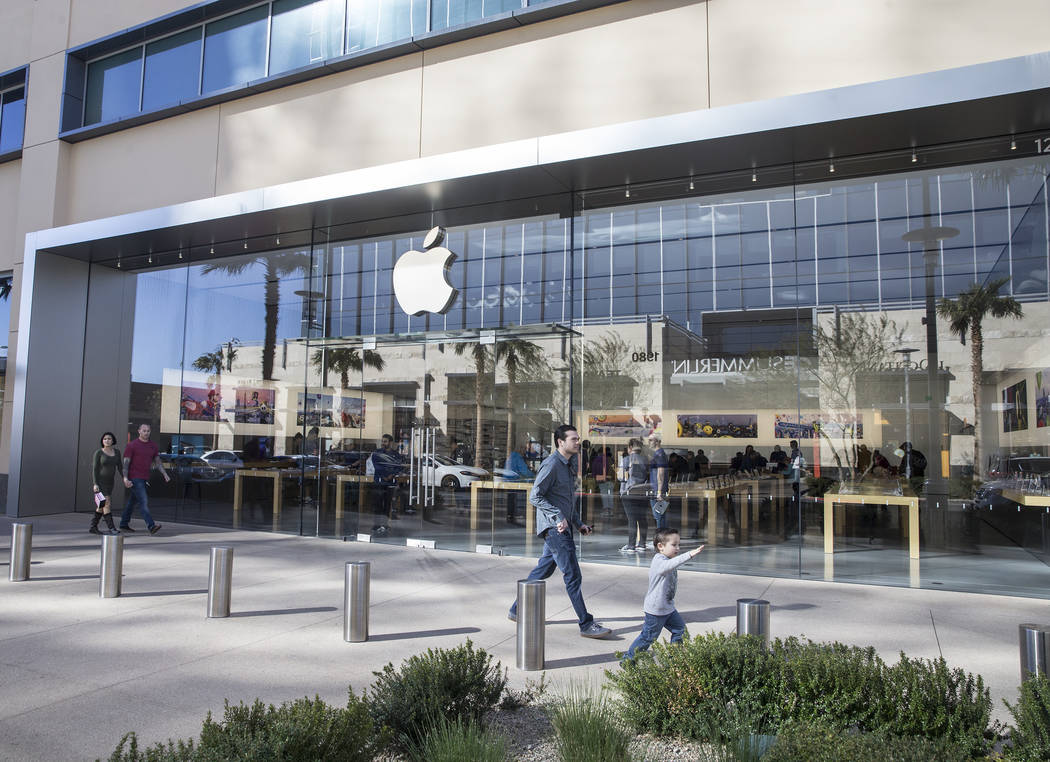 Daniel Casper, left, and son Izaiah take advantage of a mild afternoon to shop at the Apple Summerlin store at the Downtown Summerlin shopping center on Tuesday, Feb. 28, 2017, in Las Vegas. (Benj ...