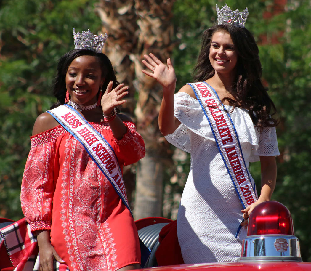 Kennedy Chase, left, and Amberly Nelson, Miss High School America and Miss Collegiate America 2016, respectively, wave to the crowd during the Helldorado Days Parade in downtown Las Vegas, Saturda ...