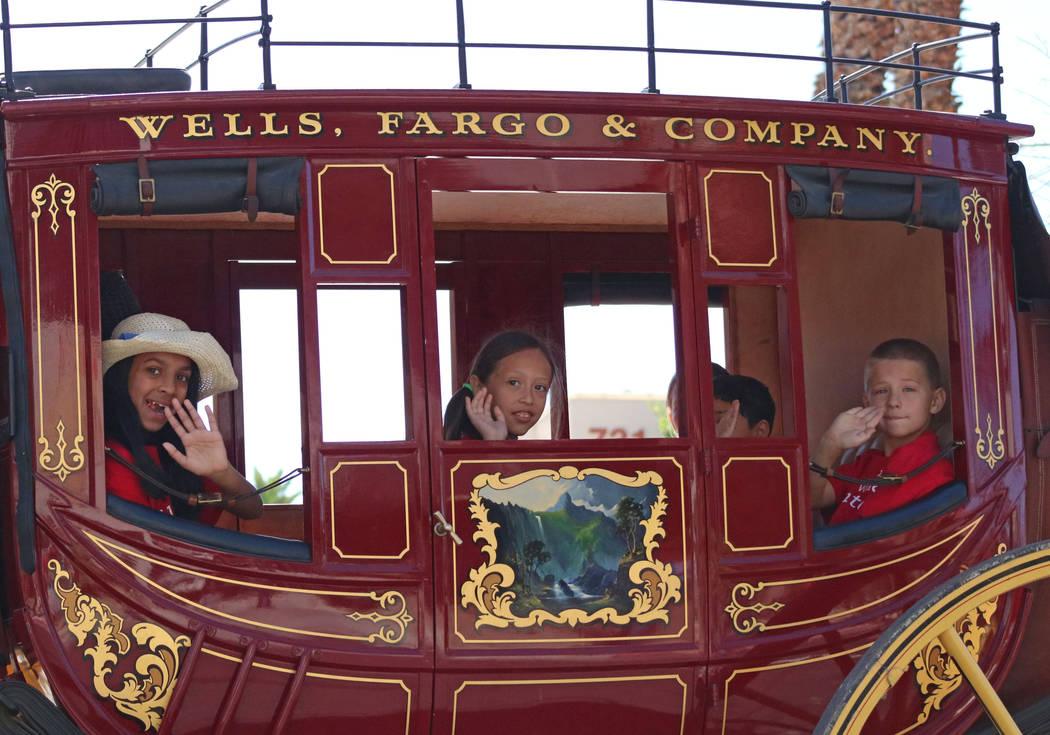 Children ride in a Wells Fargo carriage during the Helldorado Days Parade in downtown Las Vegas, Saturday, May 13, 2017. Gabriella Benavidez Las Vegas Review-Journal @latina_ish