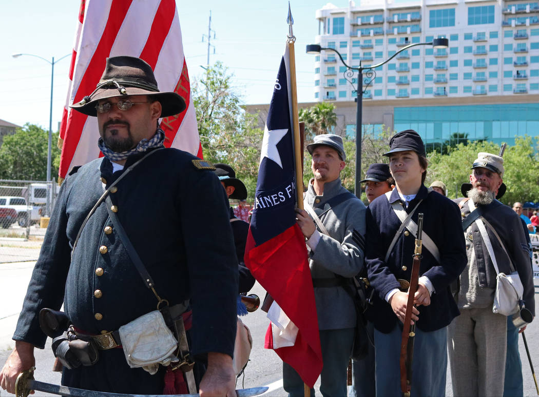 Members of the Southern Nevada Living History Association participate in the Helldorado Days Parade in downtown Las Vegas, Saturday, May 13, 2017. Gabriella Benavidez Las Vegas Review-Journal @lat ...