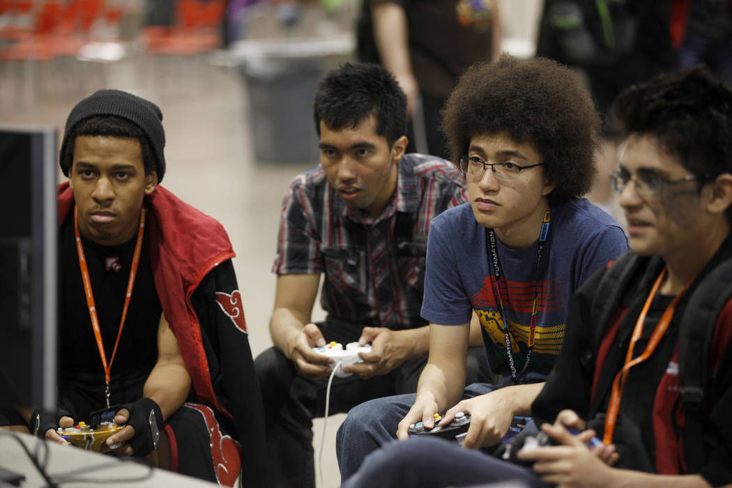 Brandon Conners, from left, Nelson Rios, Isaac Potter and Christian Reyes play Super Smash Brothers on Sunday, May 14, 2017, at LVL Up Expo at Cashman Field in Las Vegas. LVL UP is a video game, a ...