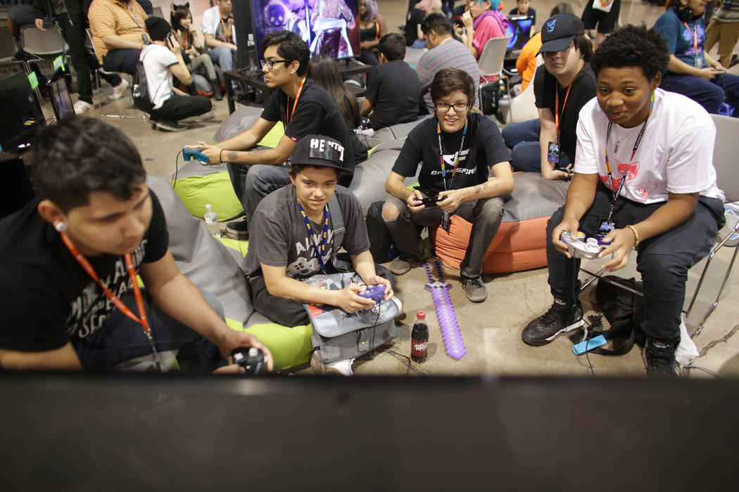 Angel Lara, 15, from left, James Martin, Alex Ross, 17, Chris Ponder and Anthony Cook, 15, play Super Smash Brothers Brawl on Sunday, May 14, 2017, at the LVL Up Expo  at Cashman Field in Las Vega ...