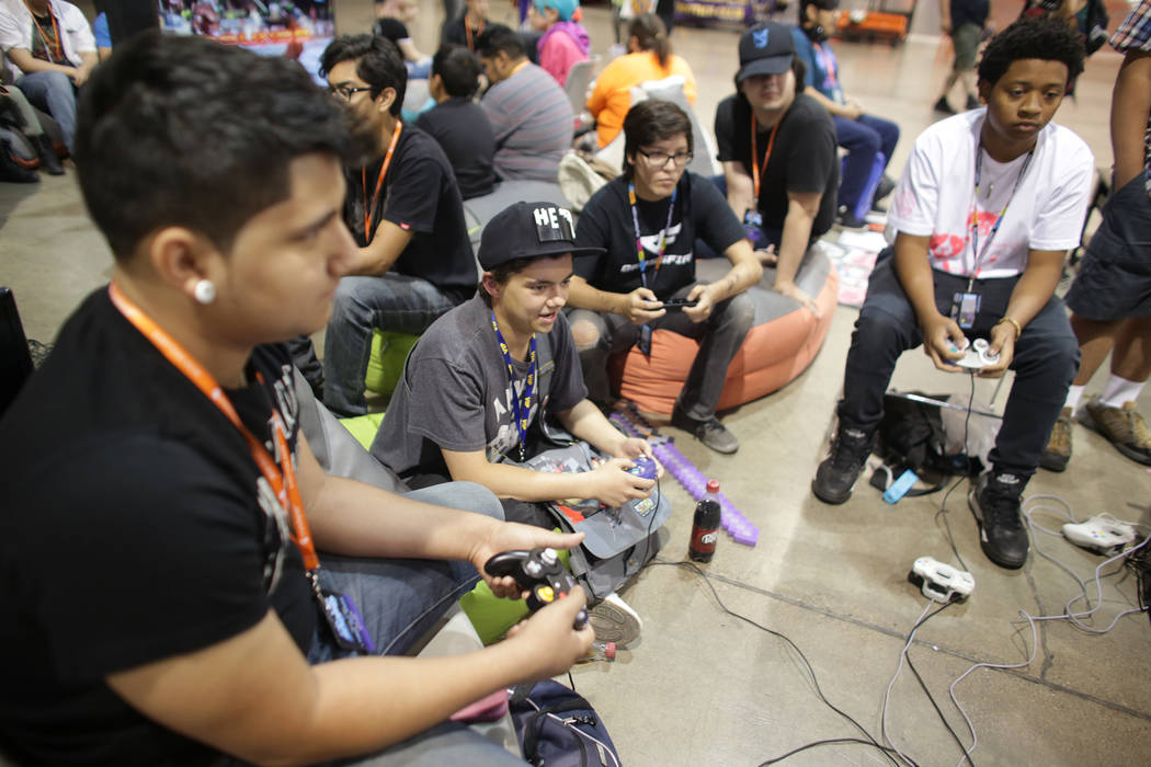 Angel Lara, 15, from left, James Martin, Alex Ross, 17, Chris Ponder and Anthony Cook, 15, play Super Smash Brothers Brawl on Sunday, May 14, 2017, at the LVL Up Expo at Cashman Field in Las Vegas ...