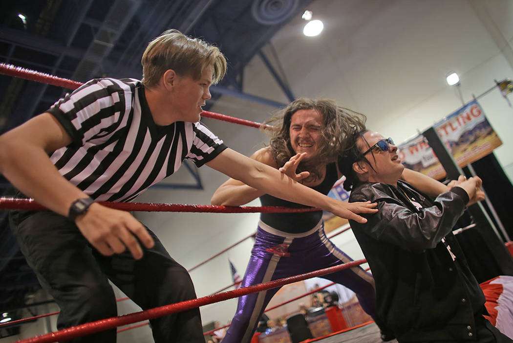 Ken Jhurko holds the arm of Ricky Tenacious through the ropes as Referee Austin Goldfield tries to stop him at the LVL Up Expo on Sunday, May 14, 2017, at Cashman Field in Las Vegas. LVL UP is a v ...