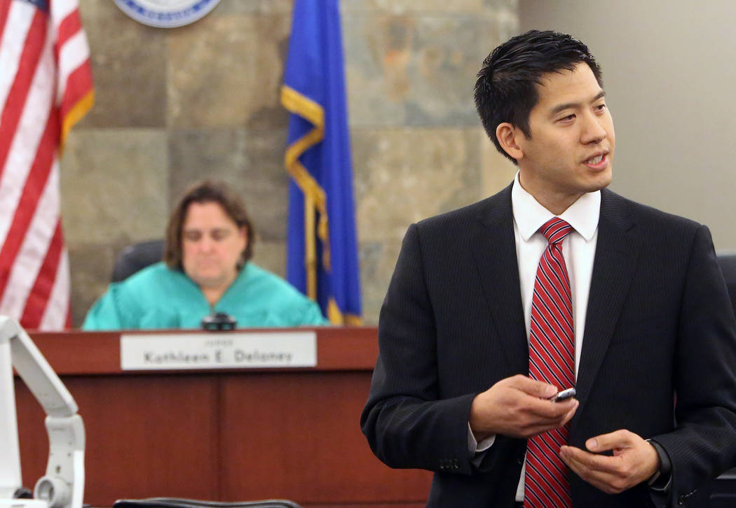 Prosecutor Alexander Chen delivers his opening statement to the jury in the trial of Dr. Binh Minh Chung, who is accused of videotaping himself having sex with patients, at the Regional Justice Ce ...
