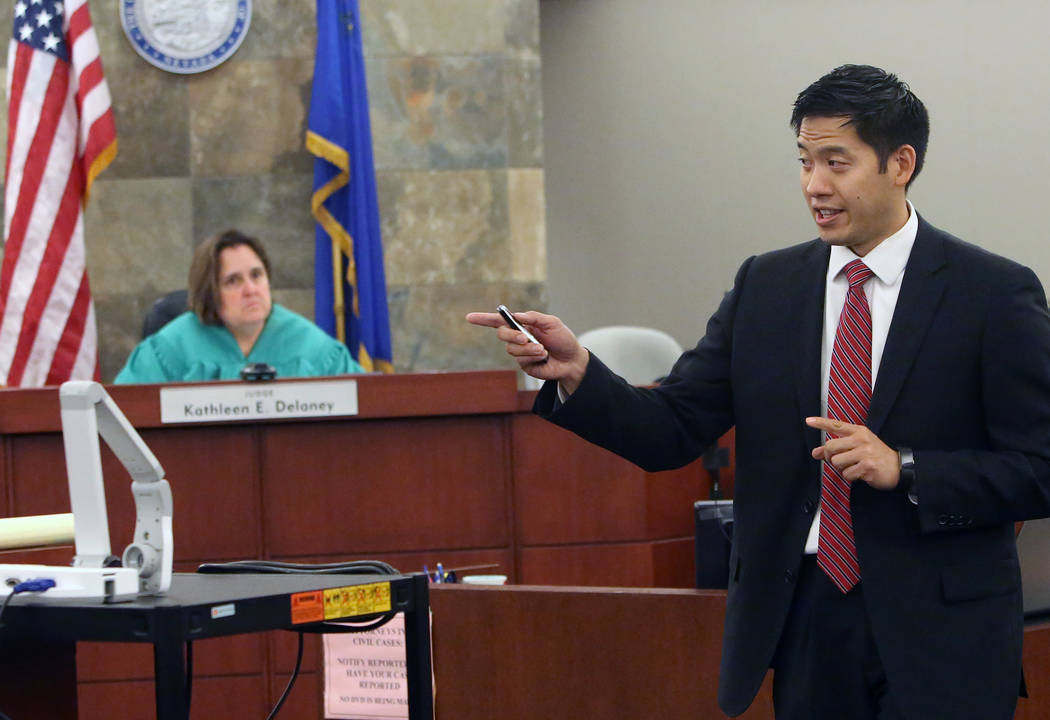 Prosecutor Alexander Chen delivers his opening statement to the jury as District Judge Kathleen Delaney looks on during the trial of Dr. Binh Minh Chung, who is accused of videotaping himself havi ...