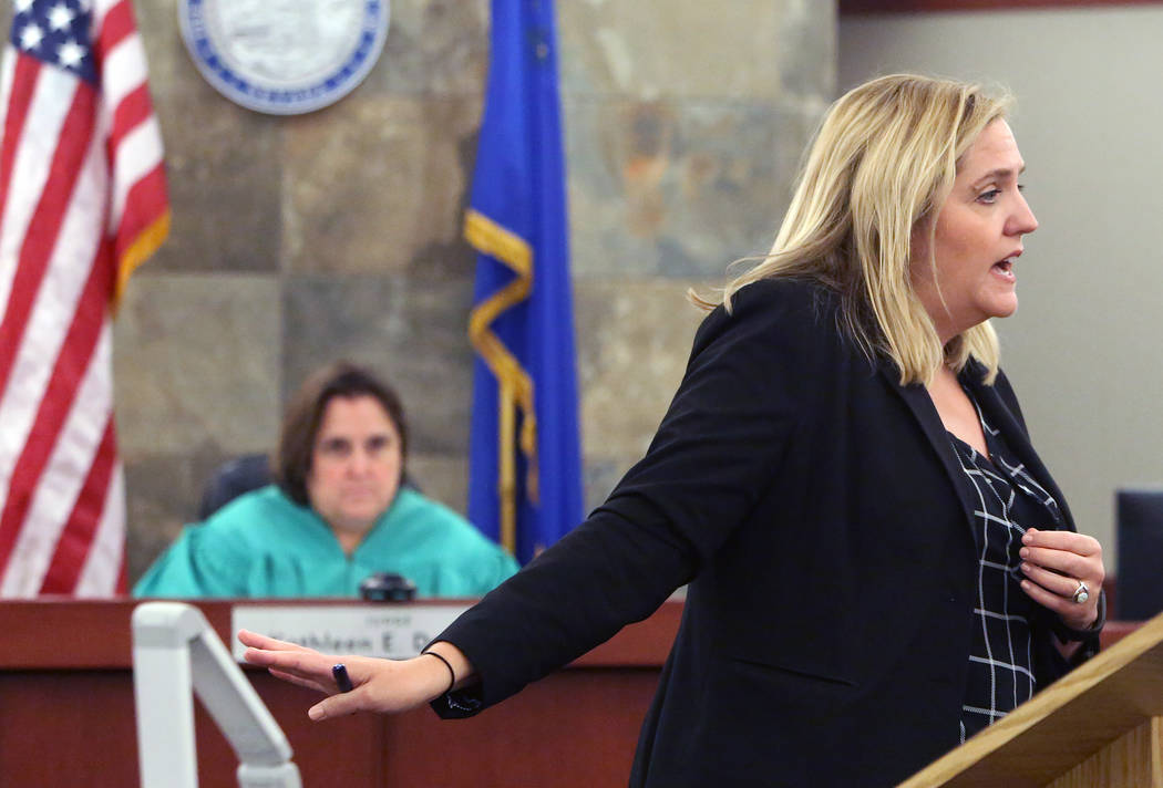Defense attorney Betsy Allen delivers her opening statement to the jury as District Judge Kathleen Delaney looks on during the trial of Dr. Binh Minh Chung, who is accused of videotaping himself h ...