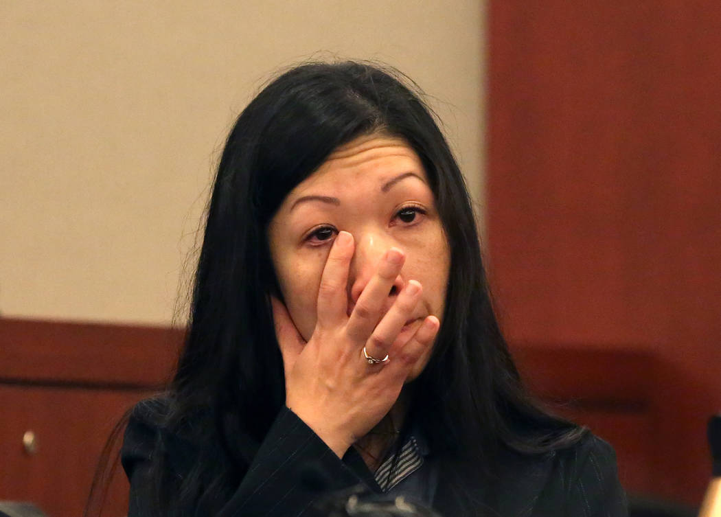 Brenda Wong, ex-wife of Dr. Binh Minh Chung, weeps as she testifies at the Regional Justice Center on Thursday, May 11, 2017, in Las Vegas. Chung is accused of videotaping himself having sex with  ...