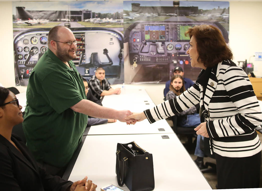 U.S. Rep. Jacky Rosen, D-Nev., shakes hands with College of Southern Nevada student Paul Woodard prior to hosting a roundtable discussion on STEM and investing in cybersecurity on Friday, May, 12, ...