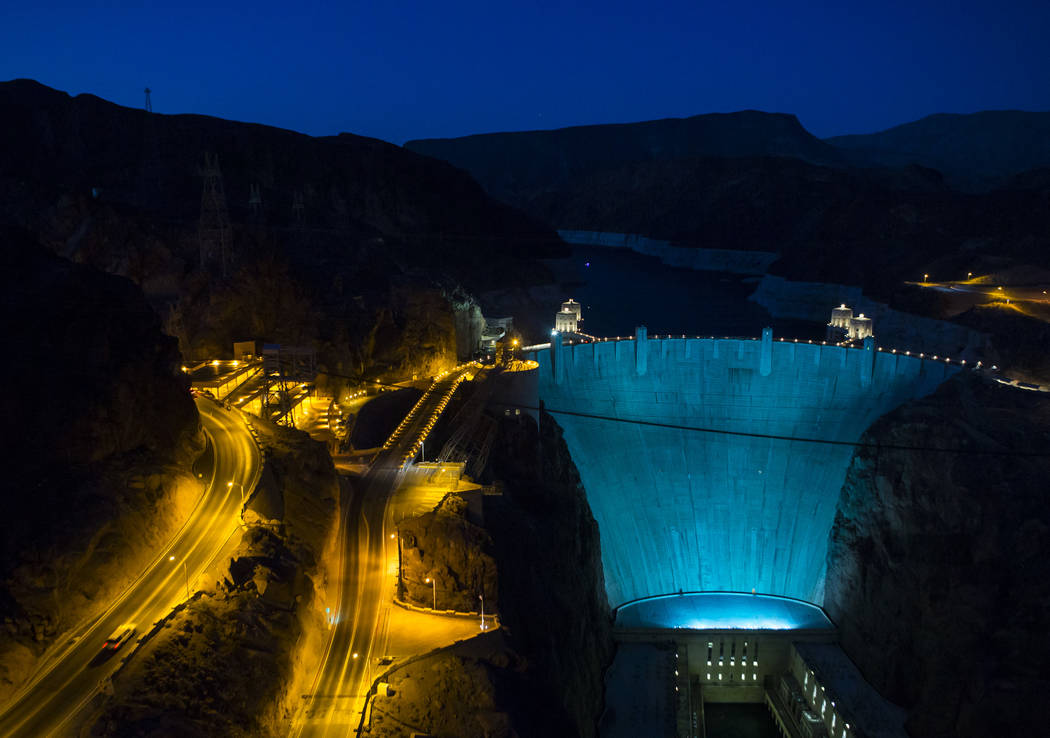 Hoover Dam, lit up turquoise to promote lung cancer awareness, as seen from O'Callaghan-Tillman Memorial Bridge on Thursday, May 11, 2017. Chase Stevens Las Vegas Review-Journal @csstevensphoto
