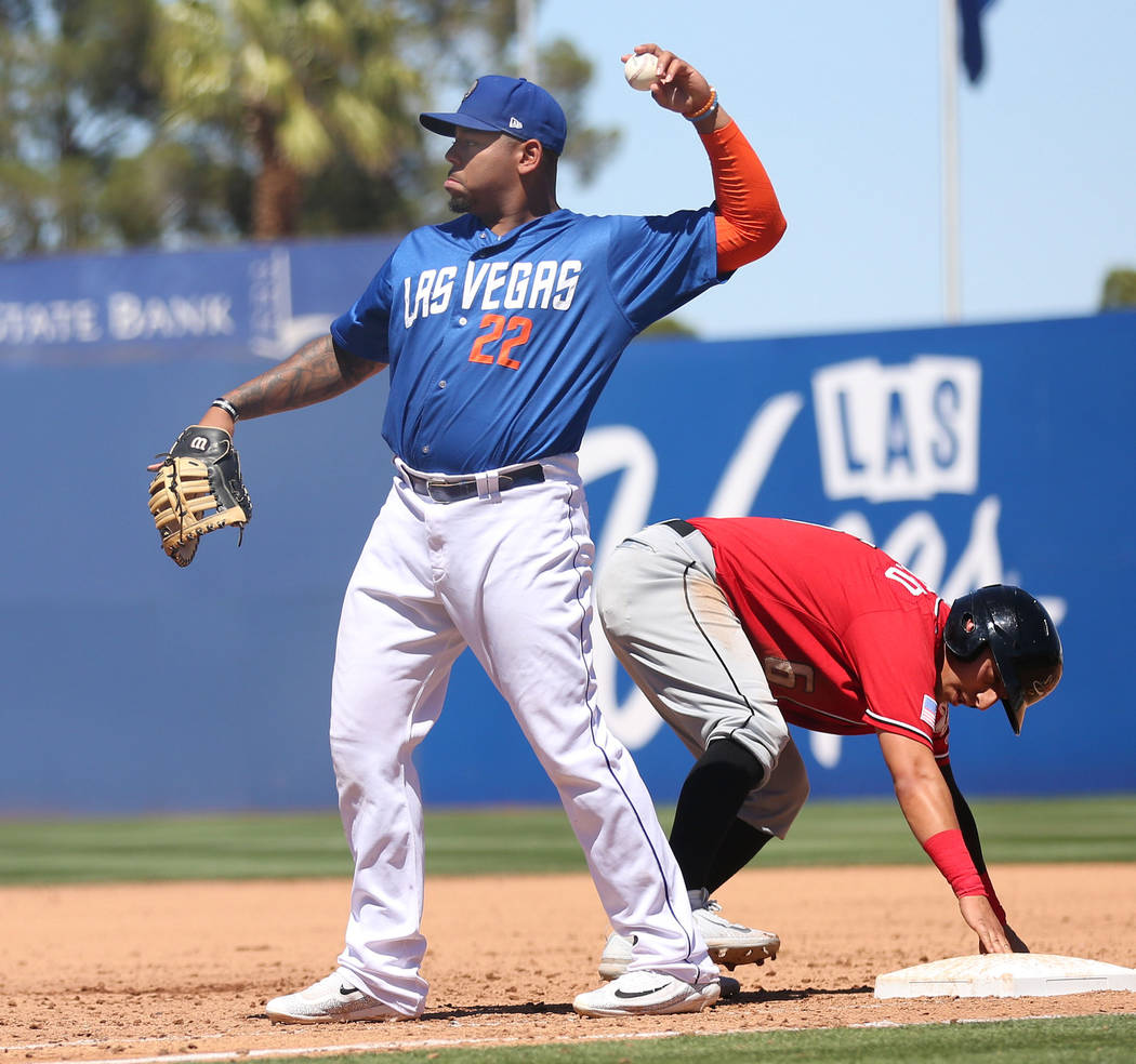 Las Vegas 51s Dominic Smith throws the ball after Albuquerque Isotopes Daniel Castro gets safely to first base at Cashman Field in Las Vegas, Sunday, April 30, 2017. Elizabeth Brumley Las Vegas Re ...